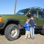 Cory's boys in front of his hunting rig